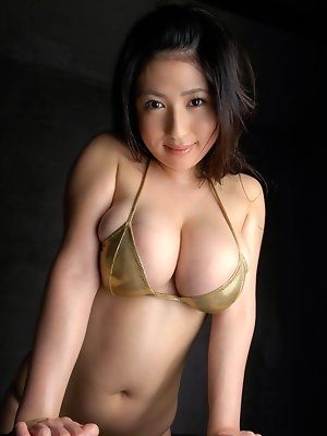 Nonami Takizawa Asian exposes immense boobs in yellow lingerie