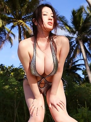 Big breasted gravure idol hotties boobs spill out of her bikini
