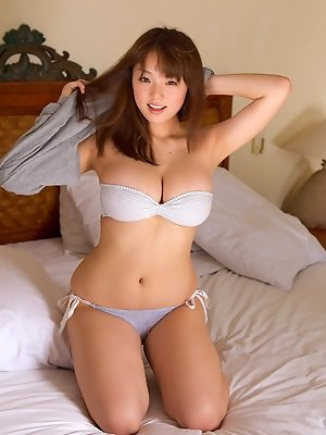 Ai Shinozaki  Asian with huge knockers plays with pillows in bed