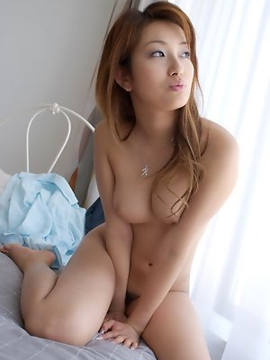 Captivating asian cutie takes off her clothing to lay naked