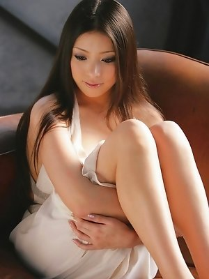 Maki Miyamoto Asian leg babe in sheer black stockings