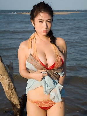Stacked asian babe shows off her big busty boobs in a bikini