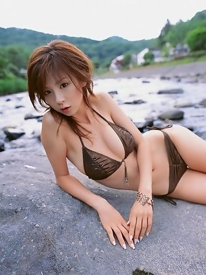 Short haired asian goddess wearing a brown bikini with perky tits